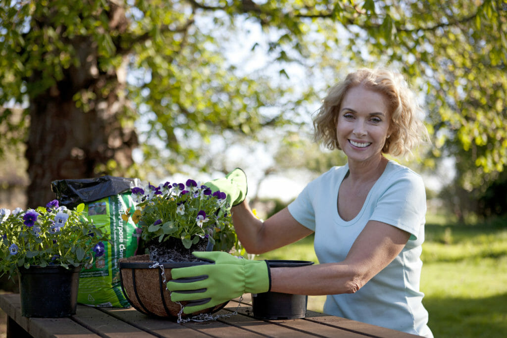 woman happily gardening