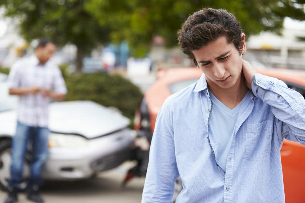Teenage Driver Suffering Whiplash Injury Traffic Accident