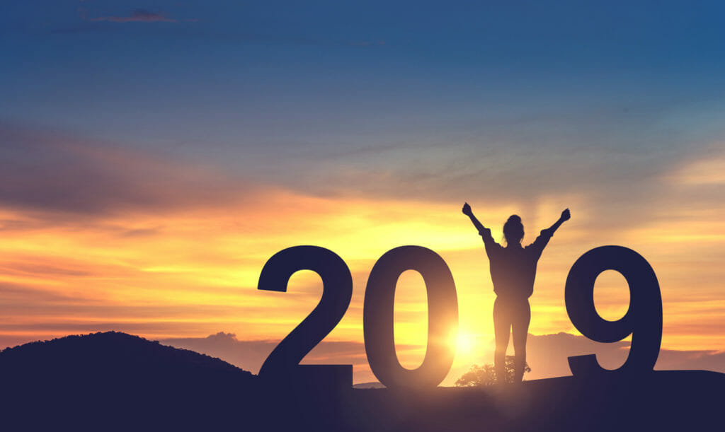 Woman enjoying on the hill and 2019 years while celebrating new year