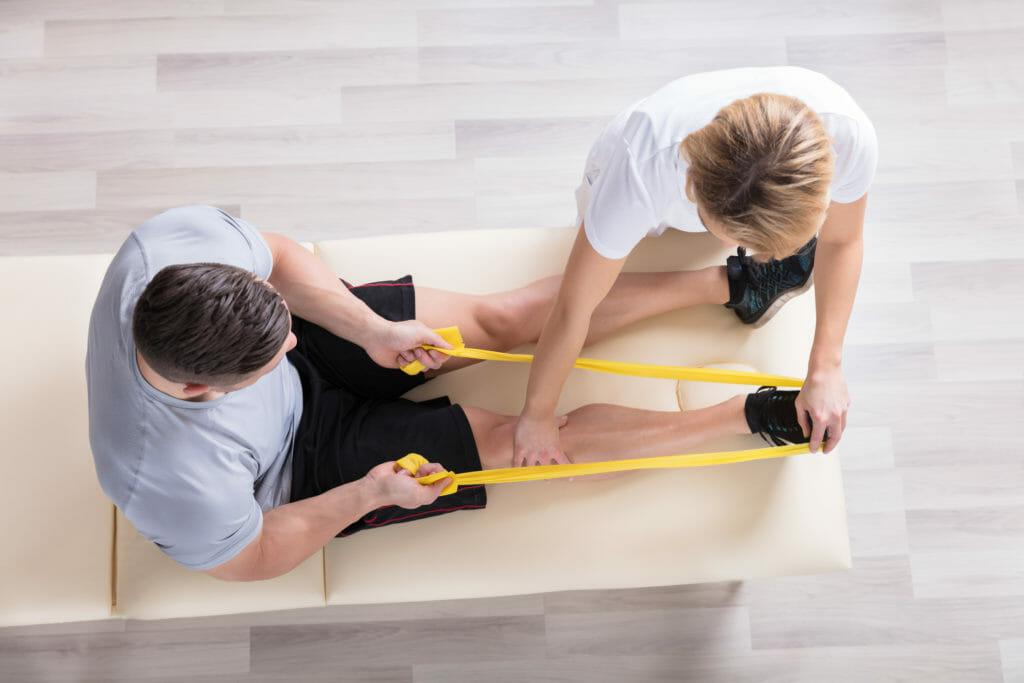 Female Physiotherapist Giving Exercise Treatment