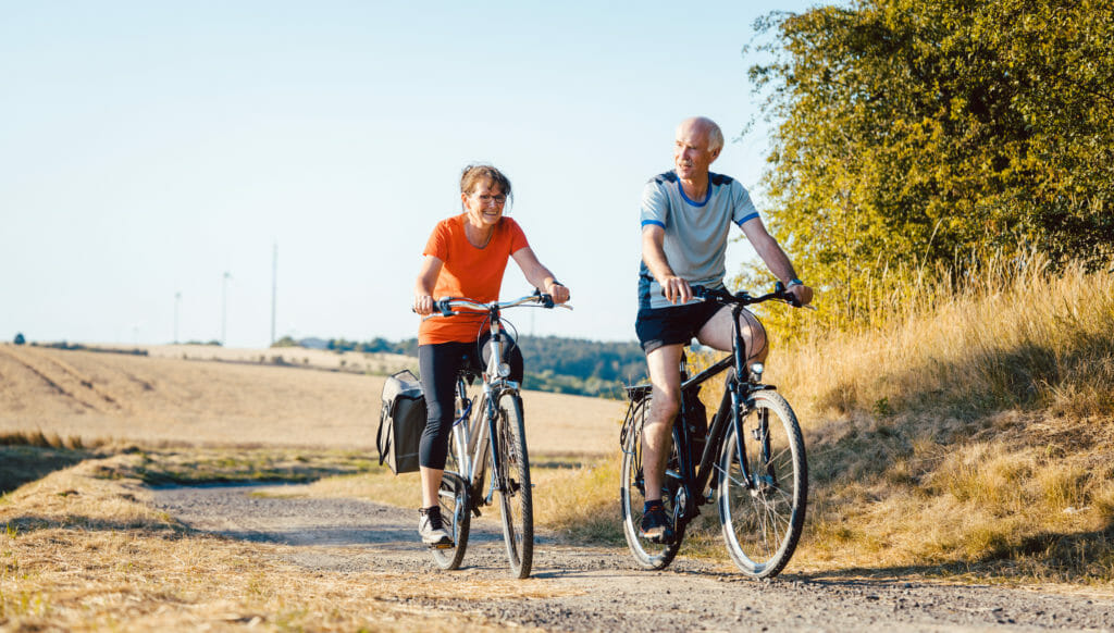 Senior couple riding their bicycles for better fitness