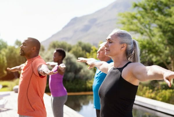 Mature group of people doing breathing exercise